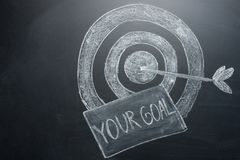 Your goal is an inscription with a target on the board. The concept of winning in business and achieving the goal.  stock photo