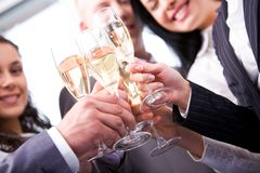 Your health!. Close-up of friends hands holding glasses with champagne and making cheers Royalty Free Stock Photo