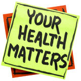 Your health matters reminder note. Your health matters reminder - handwriting in black ink on an isolated sticky note royalty free stock images