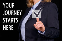 Your journey starts here. Businesswoman with touchscreen or button Stock Photography