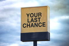 Your Last Chance. Warning Sign on Post by the Road stock photos
