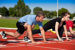 On Your Mark. Runners on the starting line.   Selective focus on first runner Stock Photography