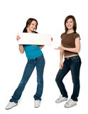 Your message here. Two teen girls holding blank sign. full length. white background Stock Photography