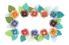 Your message here. 12 origami roses decoration on a white background royalty free stock photo