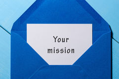Your mission inscription in blue mail envelope. Motivation concept Royalty Free Stock Photography