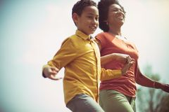 Your mom`s hand guides you through life. Mother and son in the park stock photo