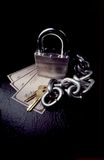 Is your money safe?. Padlock, chain, and keys on top of stack of checks Stock Photos