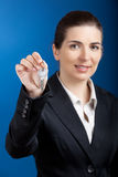 Your new keys. Beautiful young businesswoman olding keys - focus is on the keys Royalty Free Stock Photos