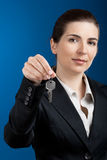 Your new keys. Beautiful young business woman olding keys - focus is on the model Stock Photography