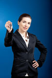 Your new keys. Beautiful young business woman olding keys - focus is on the model Royalty Free Stock Image