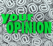 Your Opinion 3D At Email Symbol Background Feedback. The words Your Opinion on a background of 3D at or email symbol signs to illustrate feedback and contacting Stock Photography