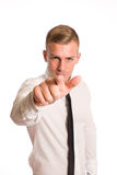 Your opportunity. Confident looking young businessman pointing straigth at the camera Royalty Free Stock Image