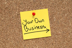 Your Own Business. Adhesive note pinned on cork bulletin board royalty free stock images