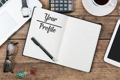 Your Profile text, Office desk with computer technology, high an. Your Profile text on note pad, office desk with electronic devices, computer and paper, wood royalty free stock images