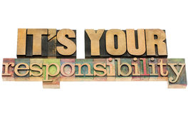 It is your responsibility. Isolated text in vintage letterpress wood type blocks Royalty Free Stock Photography