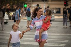 Your safety is important. Mother walking with her daughter walking over the pedestrian crossing. Close up. Copy space royalty free stock photography