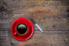 Your daily shot of coffee with cup and syringe Royalty Free Stock Photo