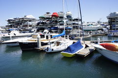 Your Speedboats, My Speedboats. These are your Speedboats and my Speedboats that are lined up at the Pier in New Port Beach, CA., these Speedboats are for Hire Royalty Free Stock Images