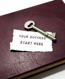 Your success start here with key on book stock photo