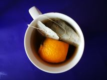 Orange and herbs tea. Tea time made with herbs and orange peeling royalty free stock photography
