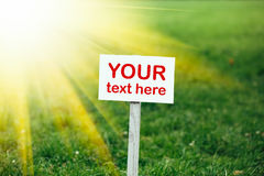 Your text here banner on green grass background Stock Photos