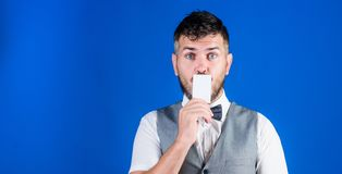 Your text here. Empty card for your contact information. Hipster with credit card. Bearded man holding business card. Businessman with bank card, copy space royalty free stock photos