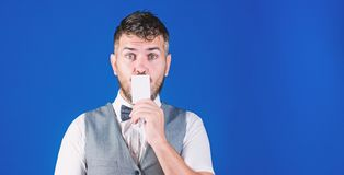 Your text here. Empty card for your contact information. Hipster with credit card. Bearded man holding business card. Businessman with bank card, copy space royalty free stock image