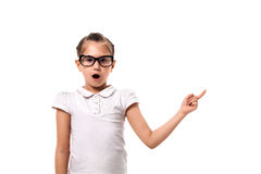 Your text here. Little girl pointing empty space Royalty Free Stock Image