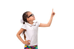 Your text here. Little girl pointing empty space Royalty Free Stock Images