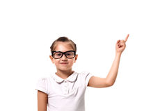 Your text here. Little girl pointing empty space Royalty Free Stock Photos