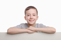 Your text here. Smiling boy standing near empty blank board. Emo Royalty Free Stock Photos