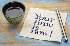 Your time is now! Napkin handwriting. Your time is now! Motivational handwriting on a napkin with a cup of tea royalty free stock photography