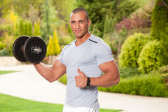 Your trainer. Portrait of a ripped attractive young fitness man Royalty Free Stock Photography