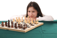 Your turn. Girl inviting to play chess Stock Photos