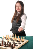 Your turn. Girl inviting to play chess Royalty Free Stock Photo