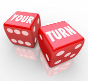 Your Turn Words Two Red Dice Game Competition Next Move. Your Turn words on two red dice to illustrate the next move in a game, event or competition for you to Royalty Free Stock Image