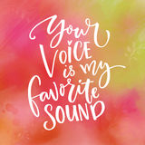 Your voice is my favorite sound. Love saying for Valentine`s day card. Typography on green and pink watercolor texture.  Royalty Free Stock Image