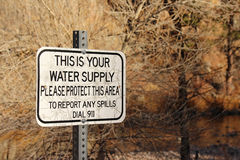 `This is your water supply ` sign. `This is your water supply` sign near river states that the area must be protected Stock Image