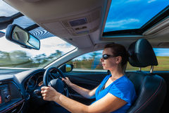 Your woman driving luxurious car on highway Royalty Free Stock Photo