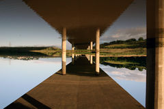 When your world's turned upside down. Reflection from road bridge taken upside down Royalty Free Stock Photo