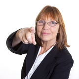Youre Fired. Older senior business woman's arthritic hand with knobbly fingers in a pointing hand gesture Stock Images