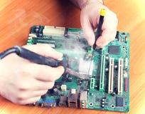 Yourself repair broken computers Stock Image