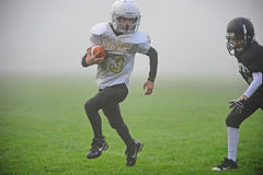 Youth American Football into the fog Stock Photo