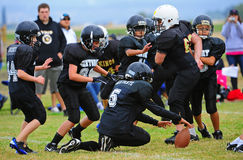 Youth American Football fumble Stock Photos