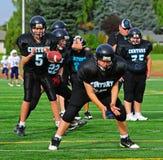 Youth American Football quarterback receives ball. September 21, 2011 American Football (Youth 7-8th Grade) Hillsboro Oregon Century High School youth program V Stock Images