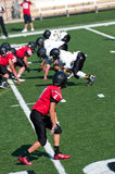 Youth American football receiver in position on the field. Stock Image