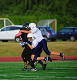 Youth American Football the take down Stock Image