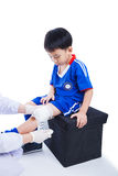 Youth asian soccer player in blue uniform. Knee joint pain. Royalty Free Stock Image