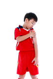 Youth asian soccer player with pain at  shoulder. Royalty Free Stock Photography