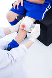 Youth asian sport boy in blue uniform. Knee joint pain. Royalty Free Stock Image